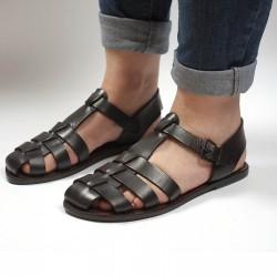 Sandalias planas marrón oscuras para las mujeres reales de cuero hecho a mano en Italia