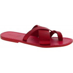 Red leather thongs braid around the big toe and leather sole