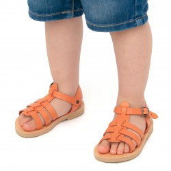 Child sandals in orange calf eather with buckle closure