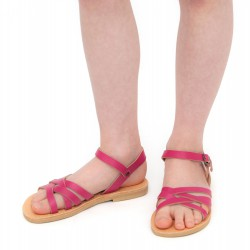 Girl's braided sandals in fuchsia calf leather with buckle closure