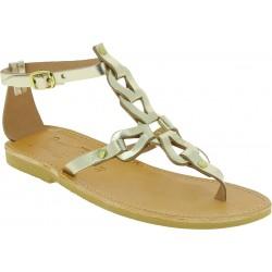 Sandalias de mujer hechas a mano con cordones cruzados en piel de becerro laminada dorada