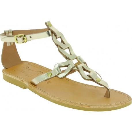 Handgefertigte sandalen für Damen mit gekreuzten Schnürsenkeln aus gold laminiertem Kalbs leder