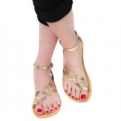 Handgefertigte Damen sandalen mit Kreisen aus goldlaminiertem Kalbsleder