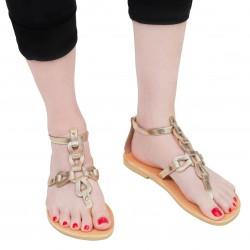 Sandali infradito da donna con lacci incrociati fatti a mano in pelle di vitello laminata oro