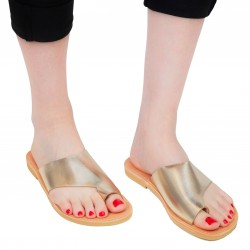 Women's handmade flat thong sandals in gold laminated calf leather